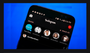 image of iPhone with Instagram dark mode